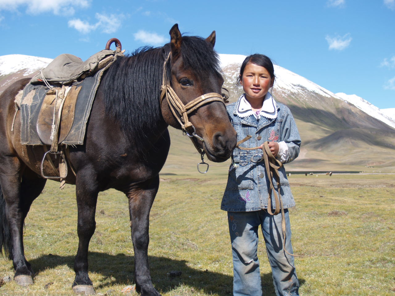 Young Mongolian Girl with her horse